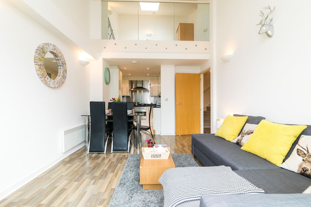 Open plan living space with high ceilings & mezzanine level