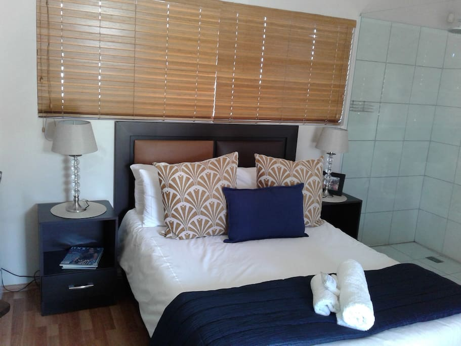 Room 5 : Double room ground floor with own patio.             Double bed with open plan bathroom, only shower