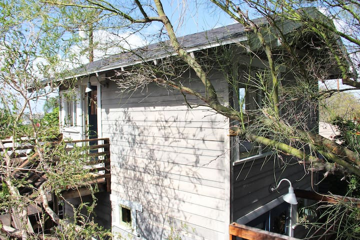 the garden house has two independent private studios: garden studio with patio deck and the tower studio with upstairs balcony deck