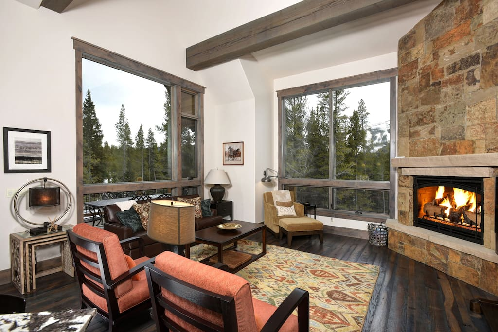 features gas fireplace, TV, cozy seating and beautiful views!