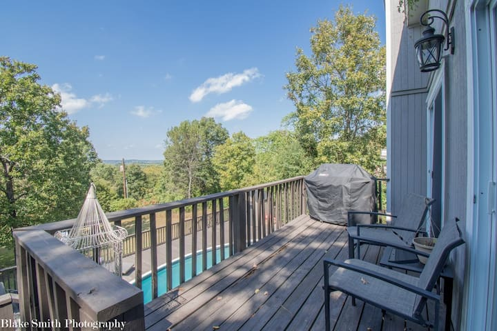 Top deck with seating area, Weber 310 propane grill, and breathtaking west facing views. Spacious back deck with swimming pool, fire pit and games! AMAZING sunsets!