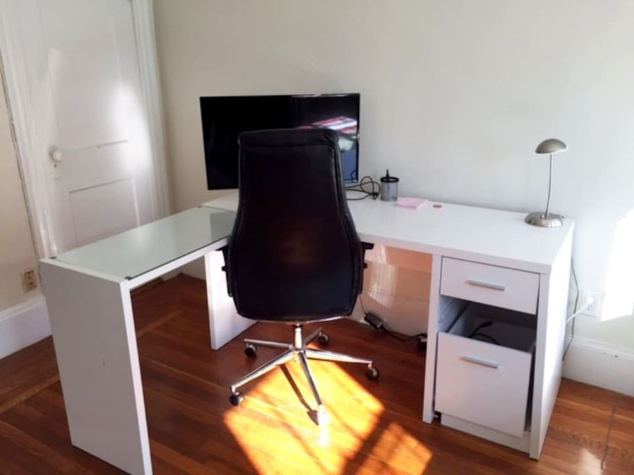 Clean desk space.  Please note the monitor is not connected to a computer.