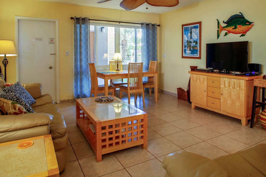 The condo is nautical themed with cheerful yellow walls