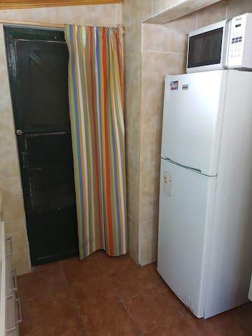 Salida lateral por la cocina