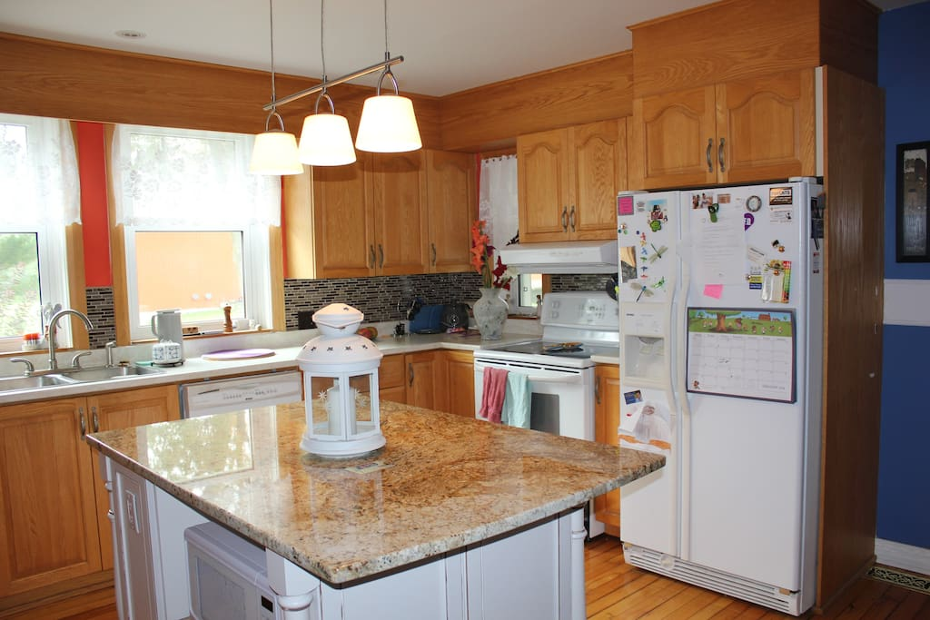 Perfect charming and spacious kitchen to invite family and guests over for a meal.