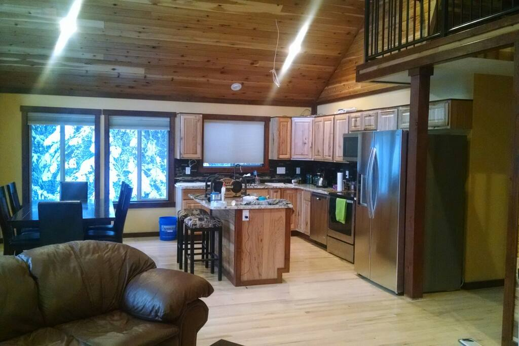 Open floor plan encompasses the kitchen, dining, and living areas. This area flows directly into the deck and is overlooked by the loft.