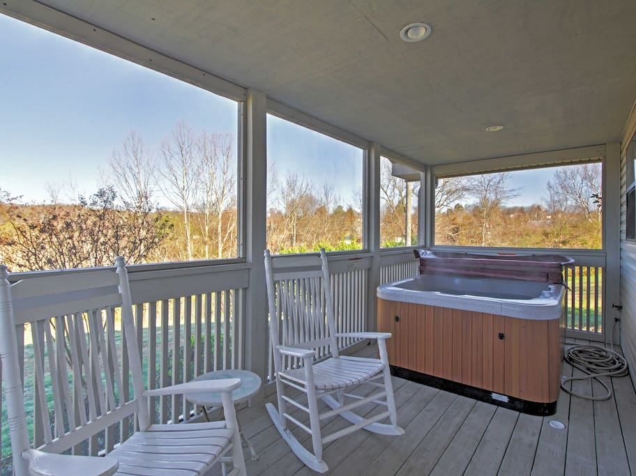 The home features a private balcony and hot tub.