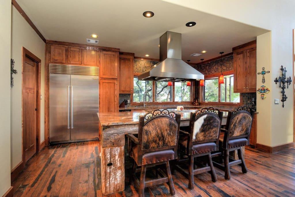 Gourmet kitchen feature wolf range and Sub zero.