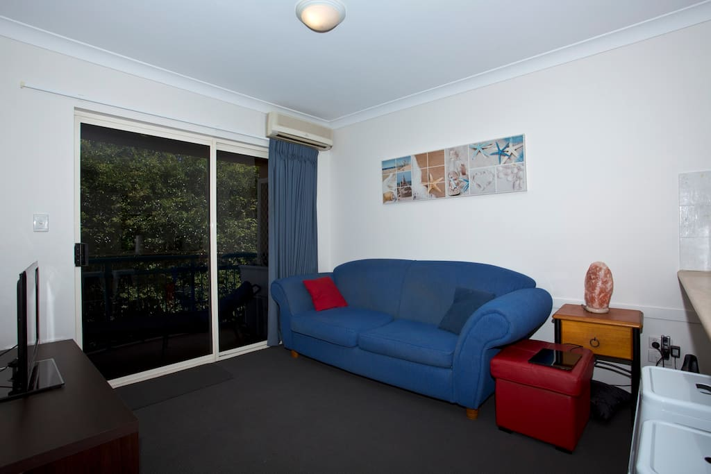 Lounge room with split air conditioning, large lcd TV, blu ray player & movie selection, 3 seat lounge/sofa bed, recent new carpet, paint and private window tinting.