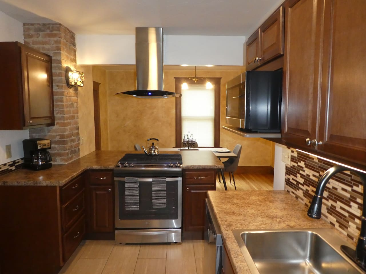 Update kitchen with tile floors and trowel wall texture