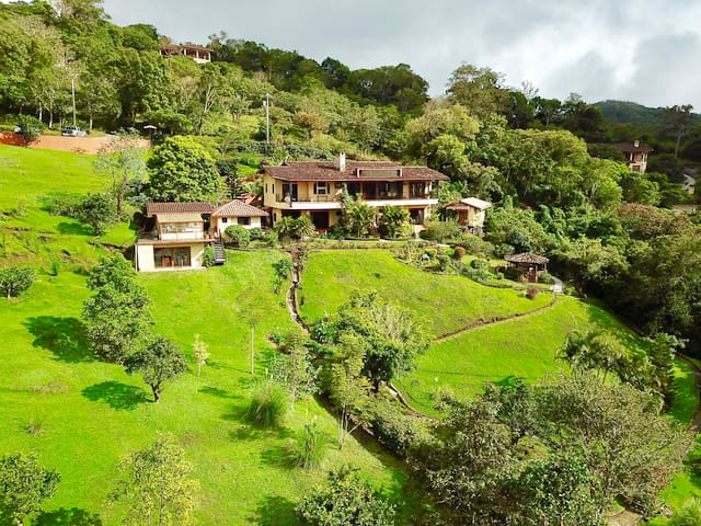 The room is on the ground floor of a luxury mountainside estate with extensive gardens and the best view of Volcano Baru in Boquete! The room is bottom right of the main house in this picture