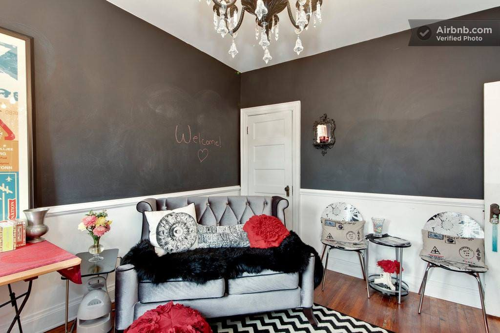 Art from famous pop artist inspire fun and style. The black walls are painted with chalkbord paint so you can write all over the room should you wish!