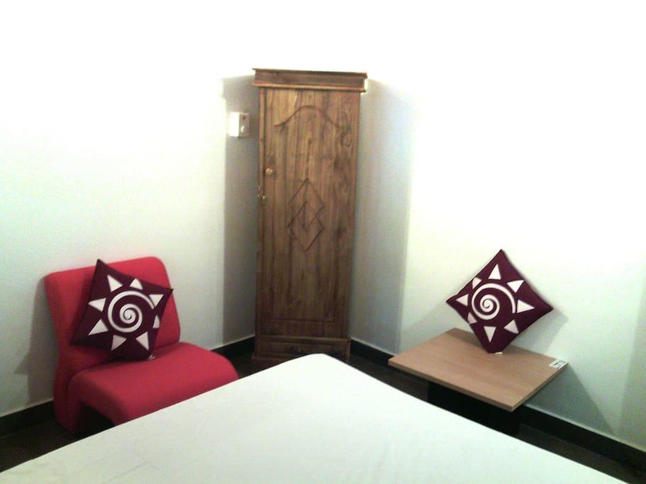 Araliya  room  with lounge chair and almirah