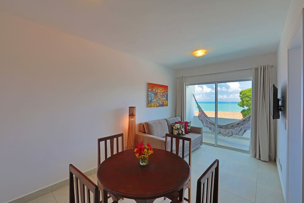 Living room, dining room table and terrace with seaview.