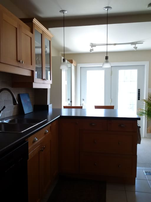 Large kitchen with walk out to deck
