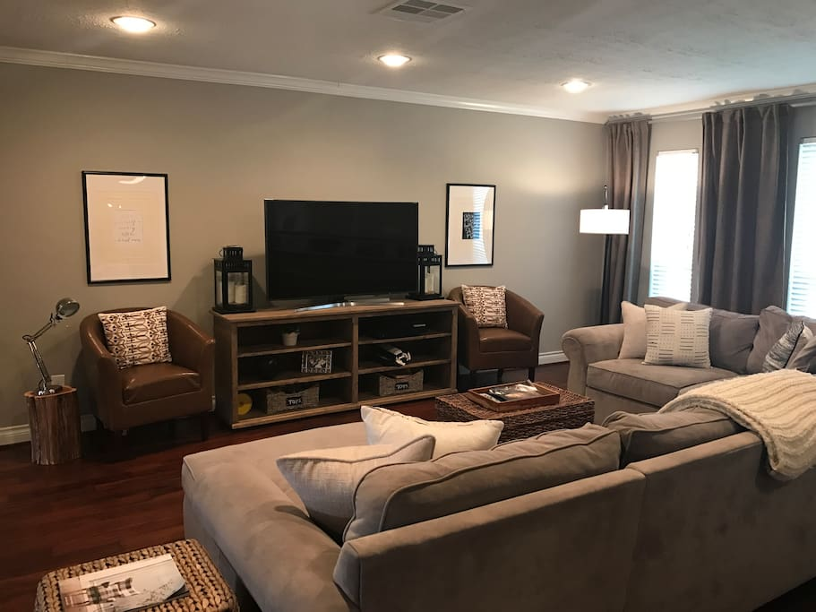 "Living room with a 55"" smart tv, comes with Netflix, amazon prime, Hulu, and more!"