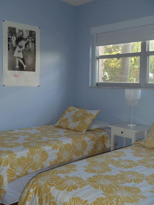 Room 1 has 2 single beds
