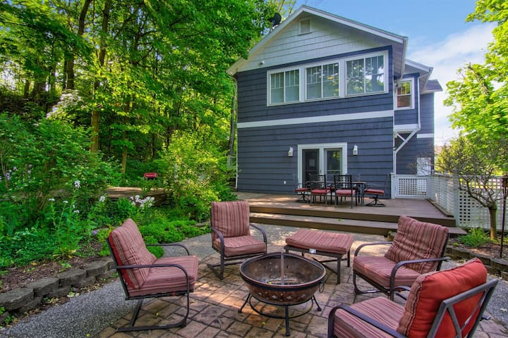 Spacious back deck and patio with fire pit and outdoor furniture
