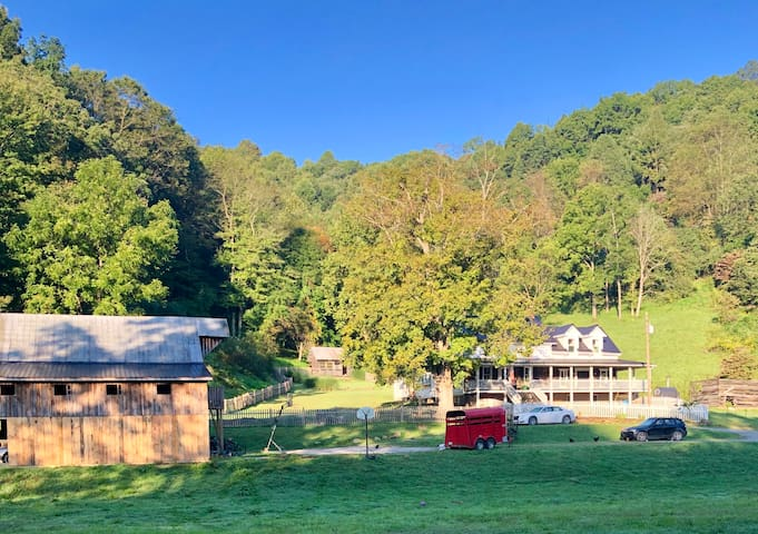 Peaceful 1850 log home on 107 acres in WV