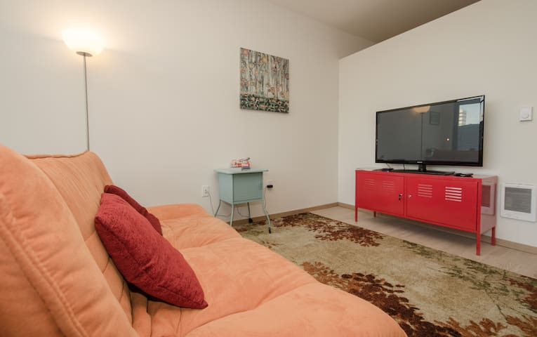 Enjoy watching Netflix on the Flat HDTV - that is if you decide to stay home :) The futon folds out to a full size bed.