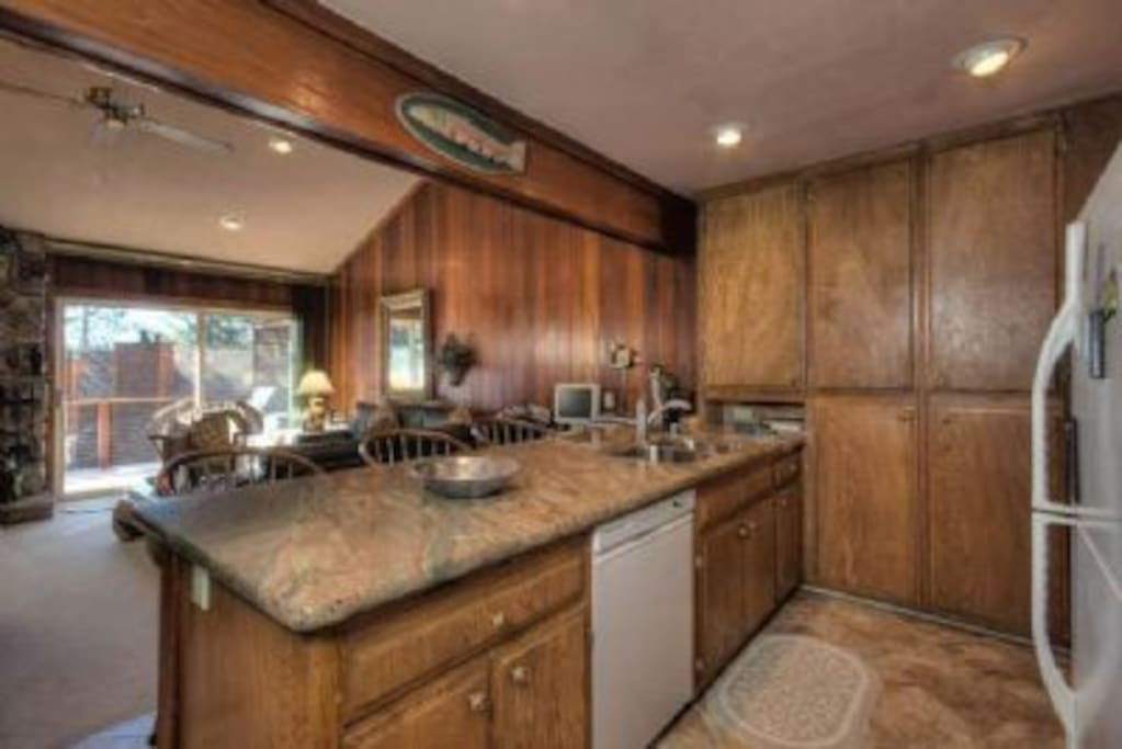 Simple yet well-equipped kitchen with granite counters...what a view