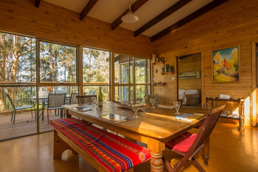 The dining room adjoins the deck