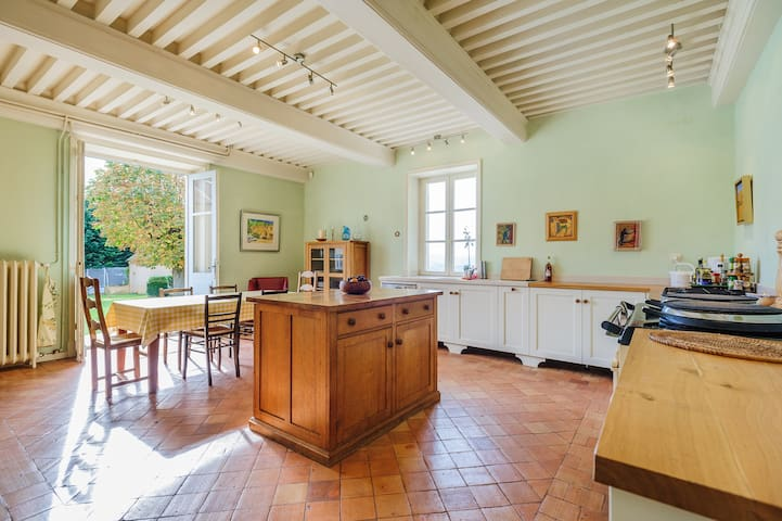 Our sun-filled South and West facing kitchen, with Aga, gas hob and electric oven.