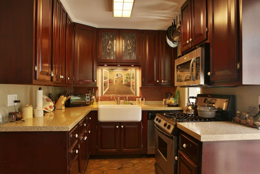 Updated kitchen with farm sink, wine fridge, stainless appliances and wine fridge.
