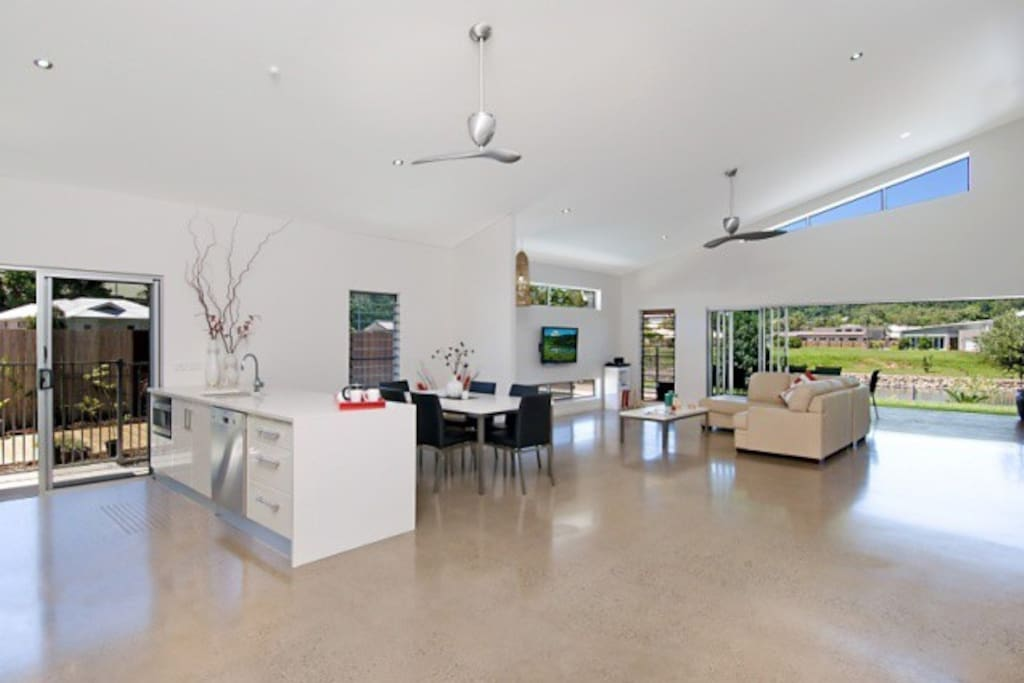 Spacious and light this modern open interior has polished concrete floors