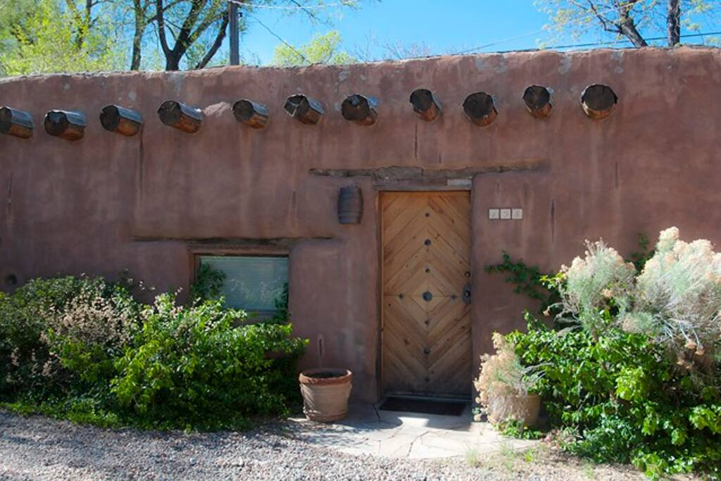 Front of house with traditional adobe and vigas...walk to The Plaza, Canyon Road and State Capitol...