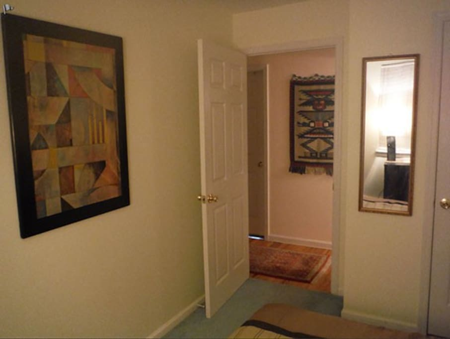 Guests' room artwork; looking towards hallway.