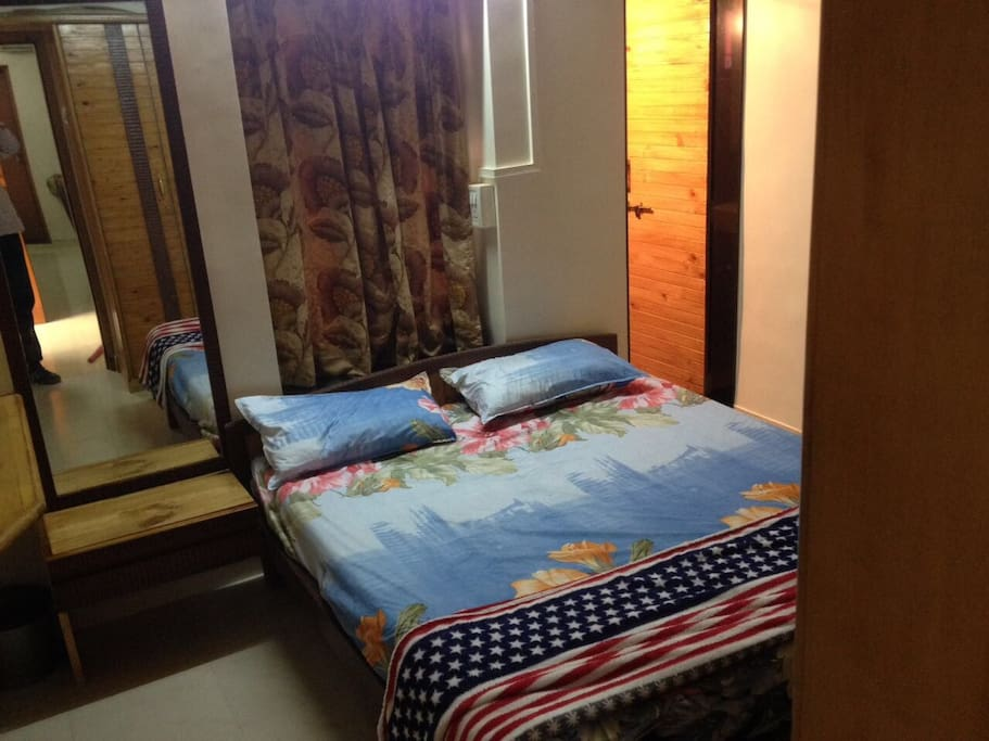 double bed which accommodates two guests along with dressing table with mirror along with attached, private washroom