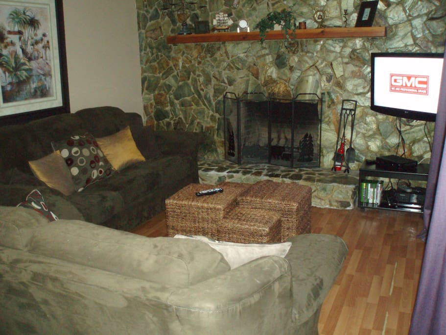 "Living room with working fireplace and 37"" HD TV, Xbox gaming, and DVD player"