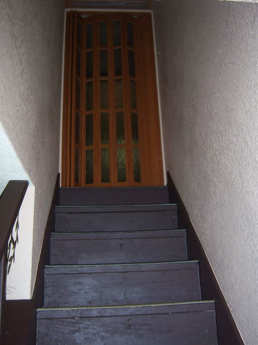 A sliding door at the top of the stairs offers privacy.