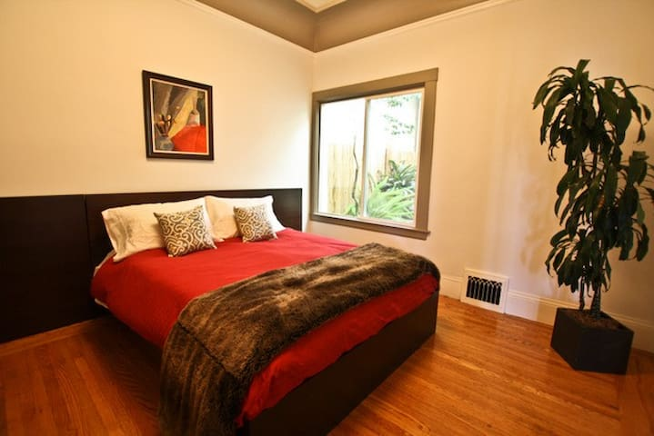 Queen size bed bedroom with views of the private patio