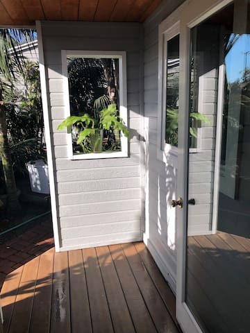 Porch off outside tropical garden that surrounds the entire property!