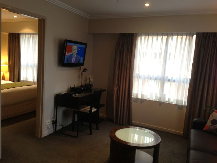 Lounge Living Room complete with Leather Sofa and Double Bed, Desk, HD TV, Blue Ray DVD & Free unlimited WiFi