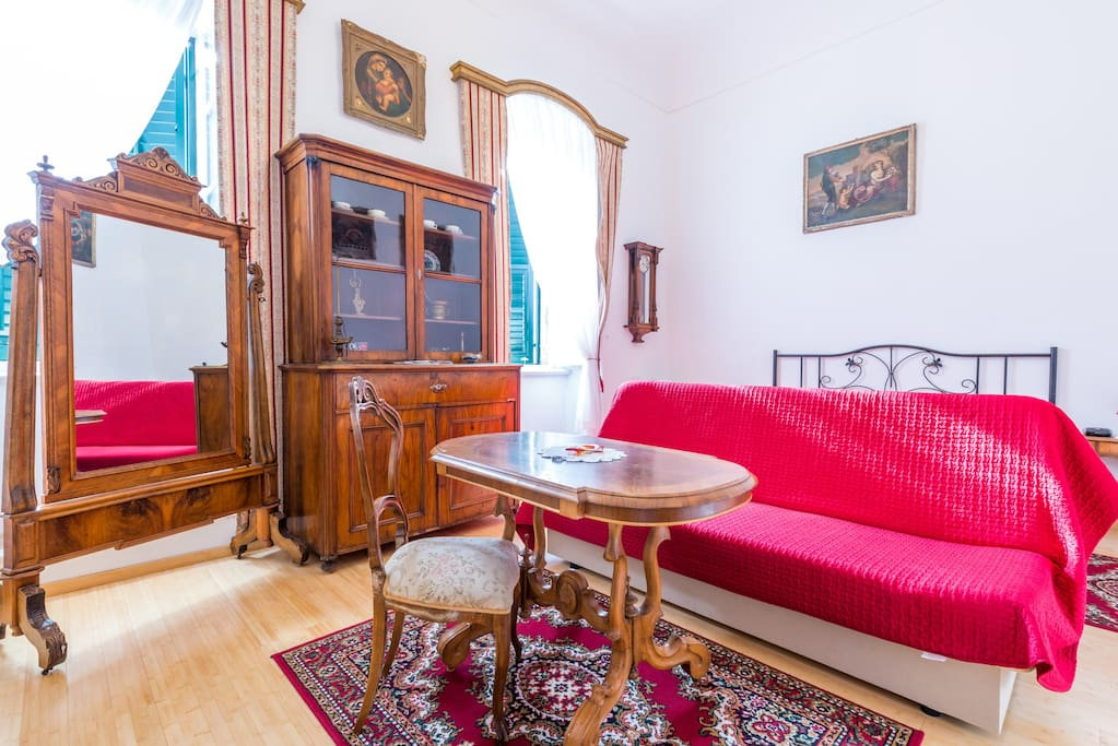 Relaxing living room with antique furniture from the old town on the main street Placa-Stradun ...
