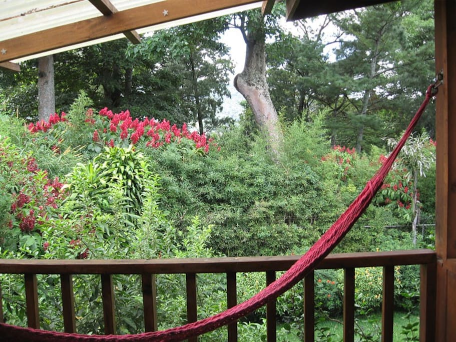 Enjoy the view of the garden while resting in the hammock on your own private balcony.