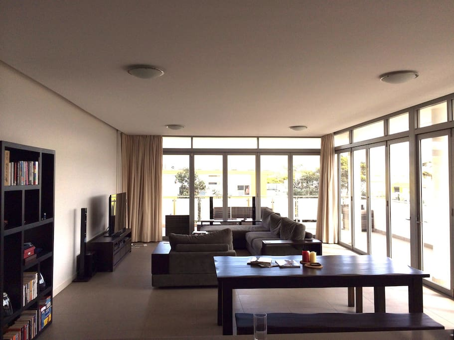 Large dining and living area. High ceilings, glass sliding doors, access to huge balcony.