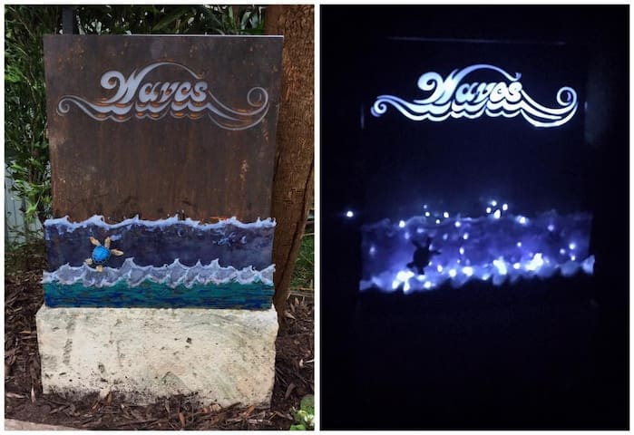 The sign at the edge of driveway! It has lights at nighttime!