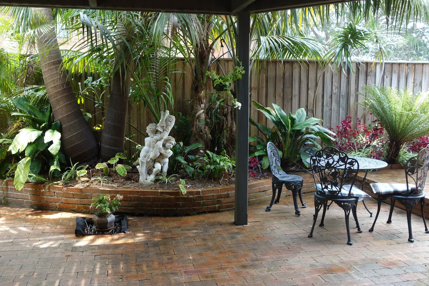 Enjoy the private patio garden of your self-contained apartment.