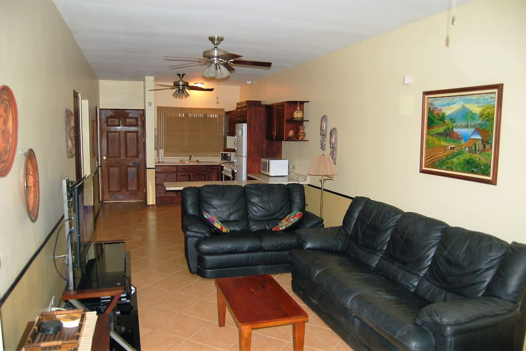 Living area w/ comfortable seating for four.