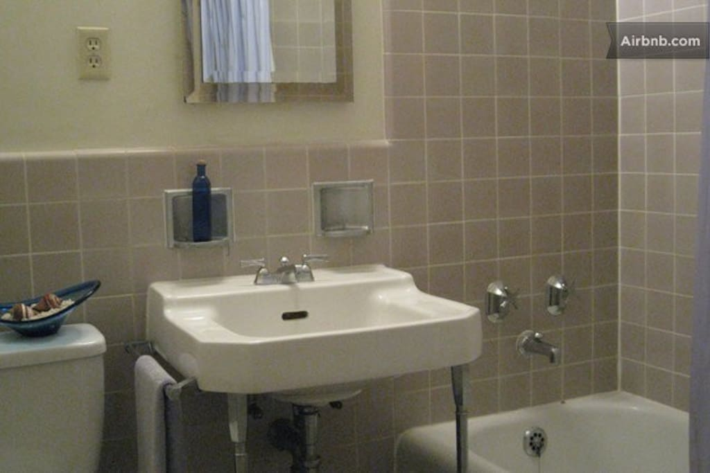 Your own bathroom with shower/tub combo.