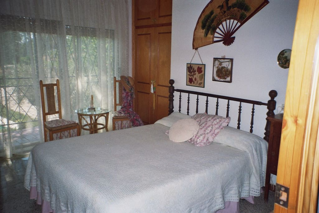 Master bedroom, own private balcony and terrace, overlooking the swimming pool