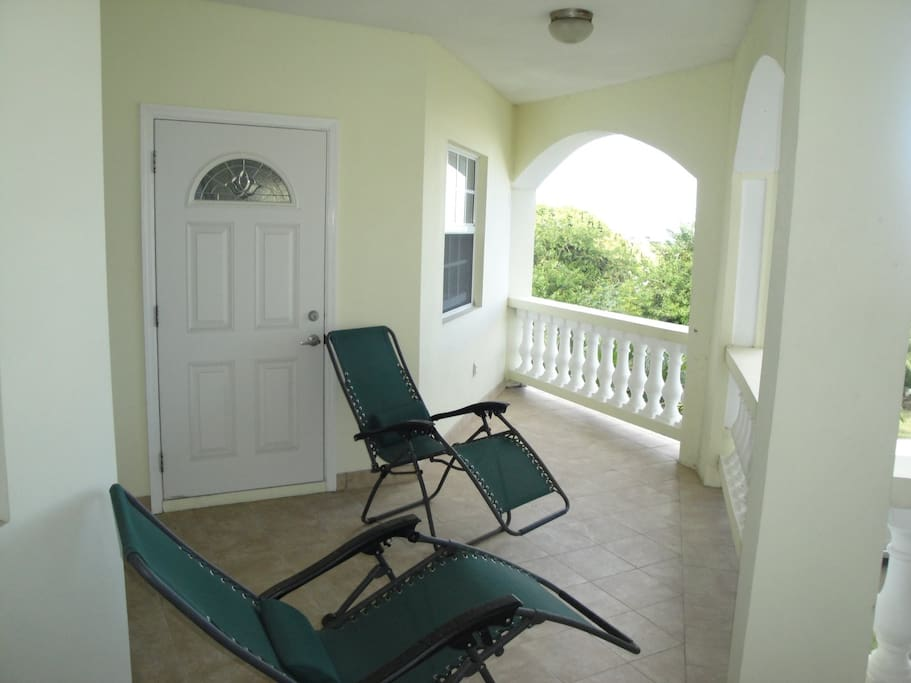 Relax on the covered porch on these zero-gravity lounge chairs and feel the Caribbean sea breezes all day long