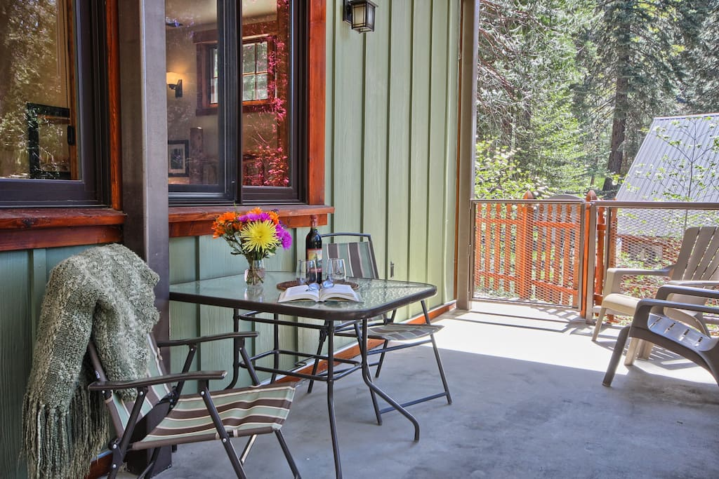 Enjoy relaxing on private deck with patio tables and lounging chairs.