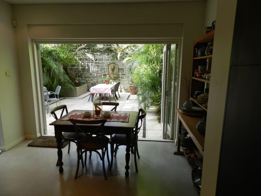 The informal dining area opens onto the courtyard