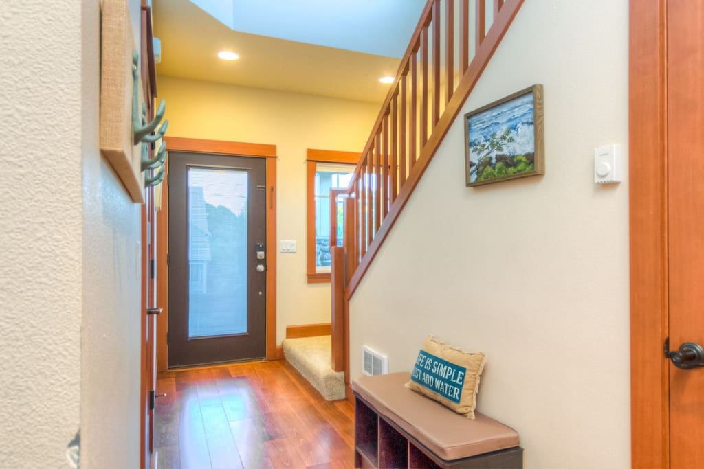 The entry to the home downstairs will lead you to the garage and 2 bedrooms.