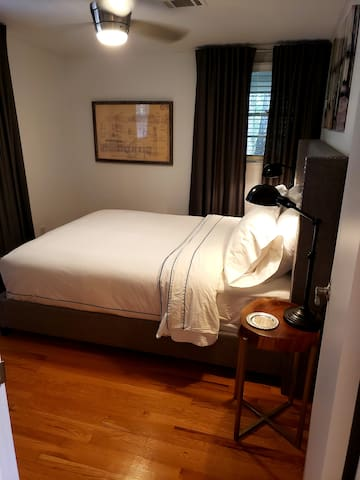 Master Suite in the Cottage portion of TippyToe Falls.  Luxury bedding and black out window treatments keep sleeping way into the morning.